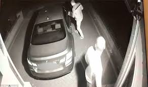 car theft 4 camera fottage of two criminals breaking into a BMW