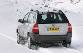 Kia Sportage 2 2008 MkII greay rear view in snow