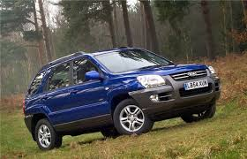 Kia Sportage 3 2008 MkII Blue forest driving