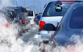 Motoring trend 2 - Rear view of cars in queue with exhaust fumes