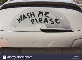 Running costs 4 dirty car door with wash me written in the dirt