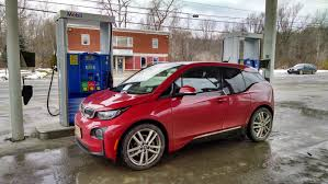 BMW i3 3 2017 version red side view at charger station